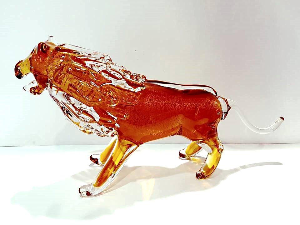 Leone di vetro colore ambrato
